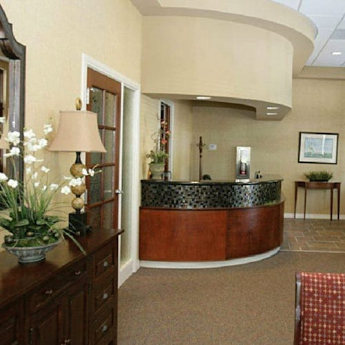 Our Charleston dental office reception area with a wooden front desk