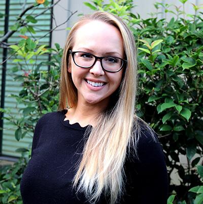 Headshot of Madeline smiling